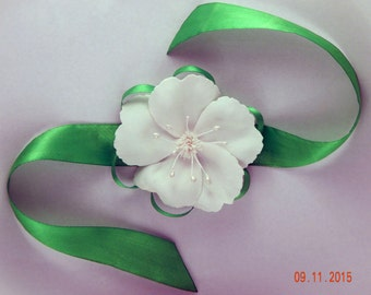 Bracelet on the arm of the Cherry flower, Wedding accessory