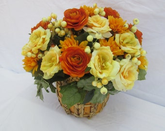 Autumn Floral Arrangement in a Wooden Basket;  Everlasting Flowers; Fall Silk Flowers; Yellow Cabbage Roses; Orange Mums/Orange Ranunculus