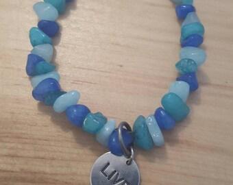 "Beautiful blue stone bracelet with ""Live"" charm.."