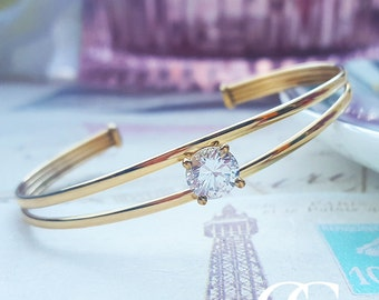 Fine 9ct Yellow Gold Torque Bangle with a solitaire CZ stone