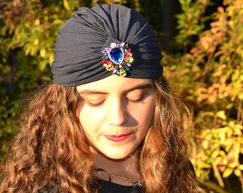 Blue turban with colored stones brooch