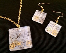 Resin pendant and earrings set with score and gears