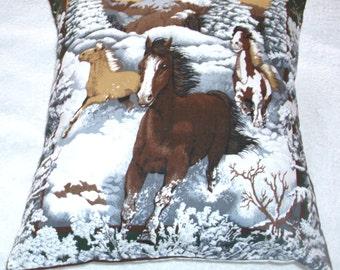 Wild Horses galloping through the snow cushion