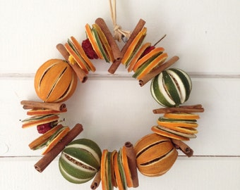 Oranges and Green Limes with Cinnamon Sticks Round Peppers Dried Fruit Festive Wreath with Scented Christmas Fragrance