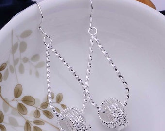 Twisted Silver Droplet Earrings with silver knot