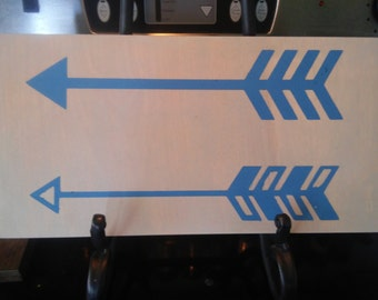 Grey and blue arrow sign
