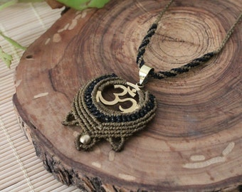 Macrame necklace with trinket in the form of OM