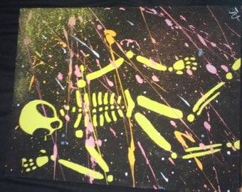 Neon Paint Splatter Alien Skeleton