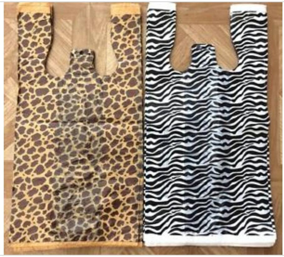 Plastic bags t shirt bags tee shirt bags by for Plastic bags for t shirts