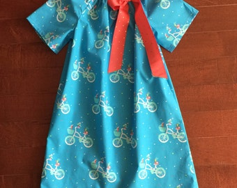Bicycle Dress with coral bow