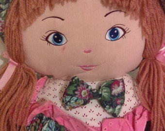 Big Rag Doll Vintage Rag doll Wearing floral dress and a hat Two pony tails with pink bow