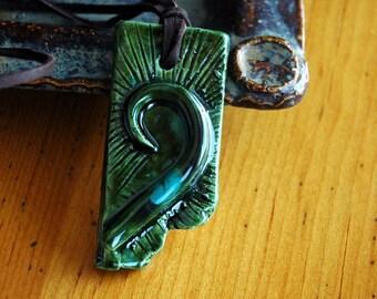 Green ceramic swirl pendant necklace