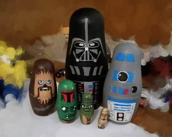 Hand drawn and painted nesting dolls