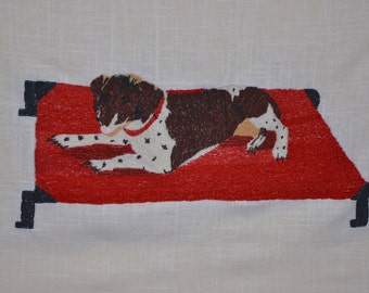 Dog On A Cot