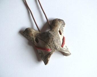 "Bone pendant ""Raven"""