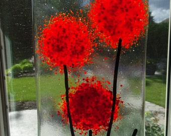 Fused glass wall hanging with red flowers