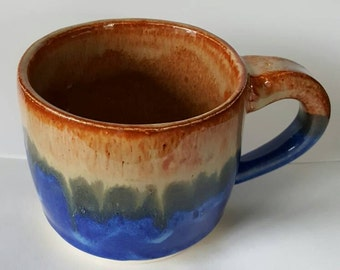 Handmade orange and blue sunrise mug cup