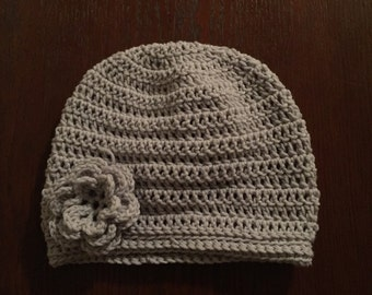 Crocheted winter hat with removable flower