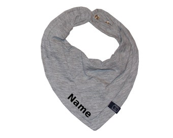 Gray bib with embroidered baby's name on it