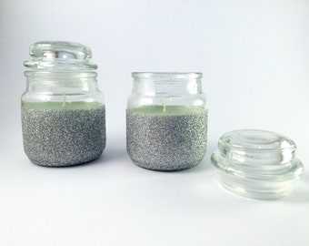 Candles in silver glitter glass jars