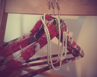 Rose patterned wooden clothes hangers