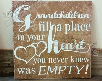 Grandchildren fill a place in your heart you never knew was empty tile
