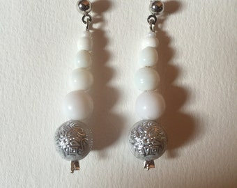 White and silver beaded earrings