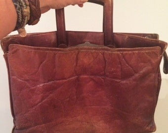 vintage, tattered, worn, scuffed old brown leather briefcase, total bohemian style bag, movie prop