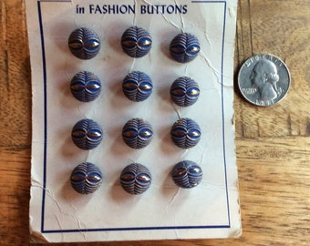 12 vintage blue and gold carded buttons.