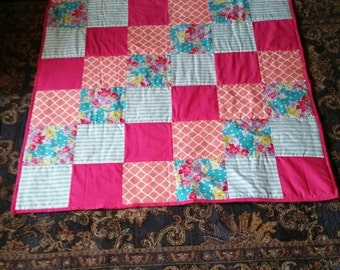 Multi-colored Crib size blanket for a baby girl