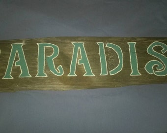 """Wooden """"Paradise"""" sign"""