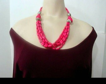 Pink vintage bib necklace.