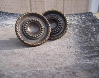 2 vintage metal knobs