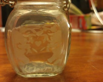 Hand etched container