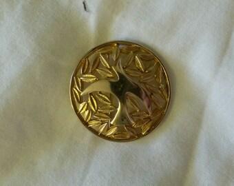 Gold-tone circular leaf and bird brooch
