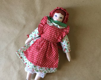 House of Hatten Porcelain Doll. Vintage Porcelain Doll. Doll Calico Dress