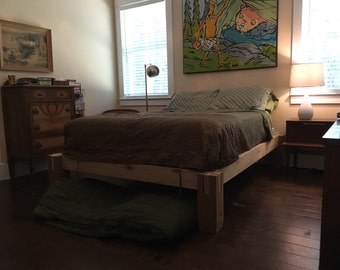 Notched timber bed frame