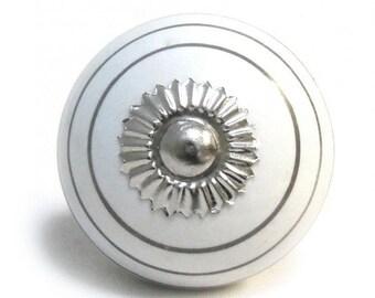 Silver striped ceramic door knob.