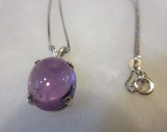 Cabochon Amethyst and solid Silver Pendant on a Sterling Silver Chain