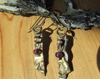Bronze and silver eardangles