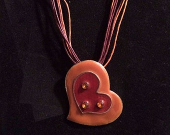 orange and red heart pendant