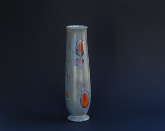 Tall, thin ceramic vase
