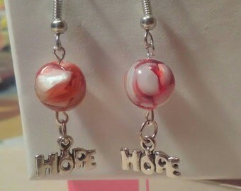 Support cancer research. Hope dangle earrings.