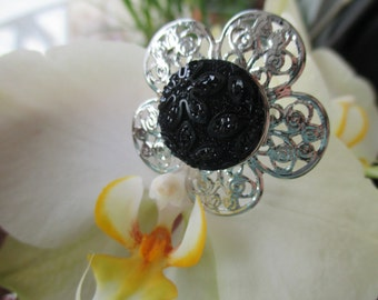 Flower bright reflections and pressure reasons black cabochon ring
