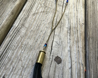 Bullet casing necklace, with deerskin leather tassles and swarovski crystals