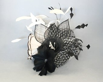 Luxurious black and white feather fascinator