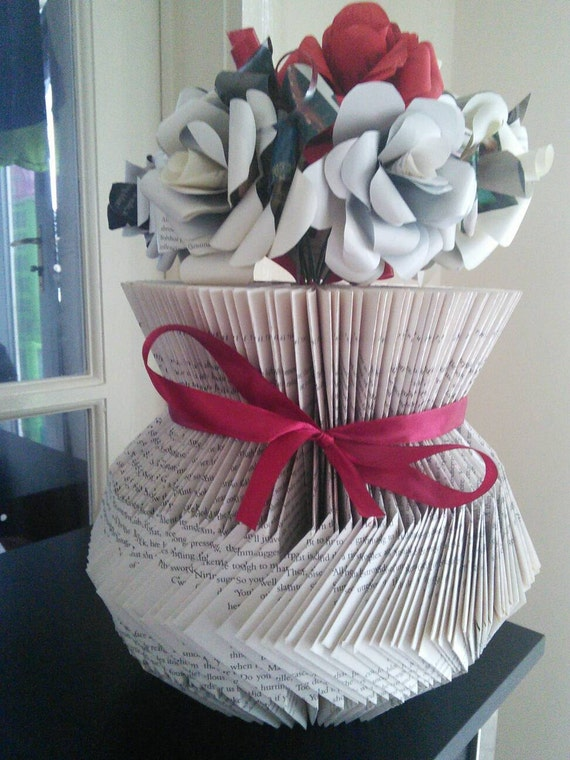 vase made from a folded book and decorated with paper roses