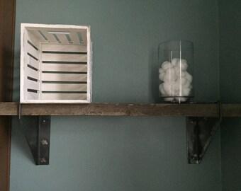 Barnwood shelf with industrial metal brackets