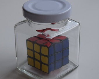 Impossible puzzle - tiny Rubik's Cube in a jar