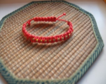 Red children's braided bracelet with rhinestone
